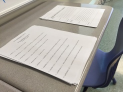 Next to the assignment drop-off bins is a bare desk where I leave handouts for students to pick up on their ways into class.