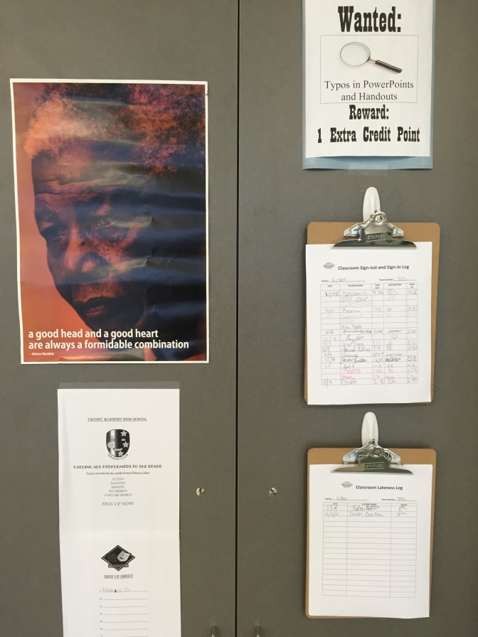 An assortment of things on the doors of my closet: a Nelson Mandela poster, a sign up sheet for the drama club, an extra credit flyer about finding typos, and the sign-in/sign-out and late-to-class logs.